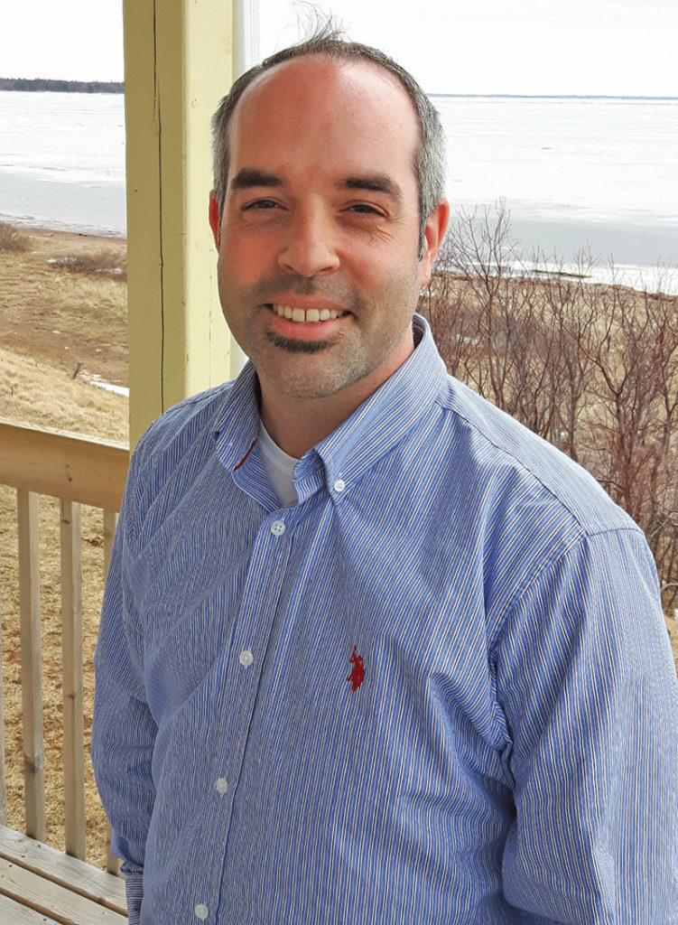 Mike Randall,  executive director of Lennox Island Development Corporation, poses at hatchery