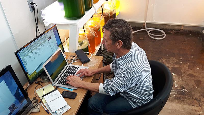 Matthew Salo working on a laptop.
