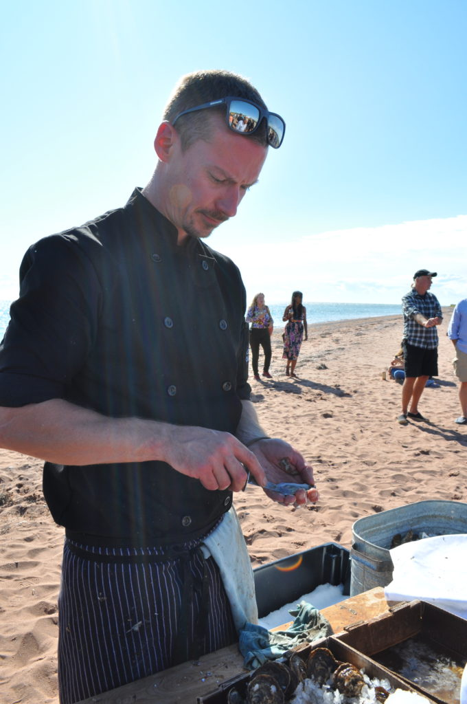 Oyster Shucker on the Beach